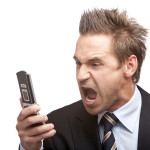 Businessman has stress - Mann schreit ins Telefon